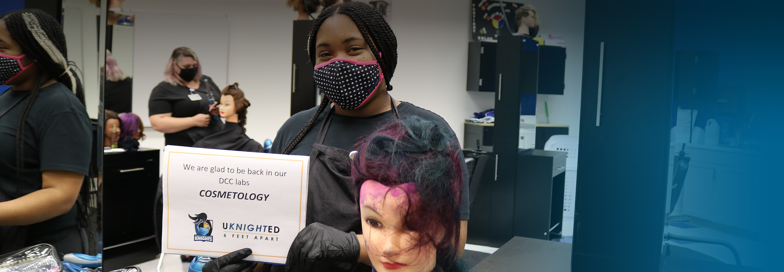 photo of DCC student wearing a mask in the cosmetology lab
