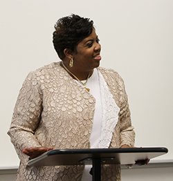 photo of Jackie Gill Powell speaking at an event